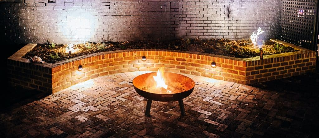 Recycled brick pad with fire pit